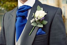 black suit, blue tie, grey vest, silver brunia berries in boutonniere