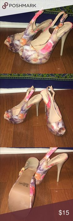 Floral Heels These heels are so perfect for the spring ! They are in great condition and are velvet . VENUS Shoes Heels