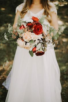 Vintage-Chic Farm Wedding in Michigan, Lush Bouquet with Blush Tones and Bold Pops of Red | Brides.com