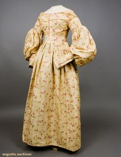 Victorian Dress - FRITTILARIA PRINTED WOOL DRESS, November, 2007 -Tasha Tudor Historic Costume Collection New Hope, PA Yellow silk and wool challis printed with pink flowers on curving green stems against brocaded windowpane ground. 1800s Fashion, 19th Century Fashion, Victorian Fashion, Vintage Fashion, Tudor Fashion, Vintage Beauty, Women's Fashion, Clothing And Textile, Antique Clothing