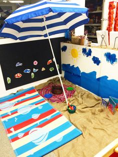 "Beach theme area at preschool - we also added shells and enjoyed a picnic for morning tea at the ""beach"""
