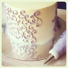 A crusting buttercream is one that will set up firmly enough so that it can be touched lightly without making a mark. Although still relatively delicate, this buttercream technique can be a very helpful asset to decorators, making a nicely primed surface for all sorts of cake decoration, from decorative piping to fondant or gum paste adornment.