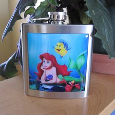 Little Mermaid Inspired Ariel Liquor Hip Flask ($36) ❤ liked on Polyvore featuring home, kitchen & dining, bar tools, grey, home & living, pocket flask and liquor flask