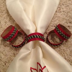 Homemade napkin rings made from toilet paper tubes and ribbon.