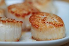 Seared Scallops - Wash and pat scallops dry.  Get them as dry as possible or they will stick to pan.  Place them one by one in very hot pan.  Do not crowd them.  Moisture and crowding will cause them to steam.  Sear 2-3 minutes per side.