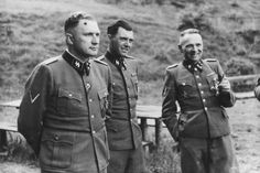 Three SS officers—Richard Baer (commandant of Auschwitz), Dr. Josef Mengele, and Rudolf Hess (the former Auschwitz commandant)—socialize on the grounds of the SS retreat of Solahuette outside of Auschwitz. Photographs from this time period (June 1944 to January 1945) coincided with the deaths of 400,000 Hungarian Jews.