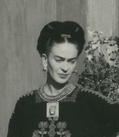 Photo by Florence Arquin of Frida Kahlo in Coyoacán, wearing a necklace made for her by Frederick Davis with a Tlatilco ceramic figure