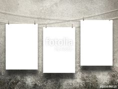 #Three #blank #frames with #pegs on #weathered and #mould #concrete #wall #background