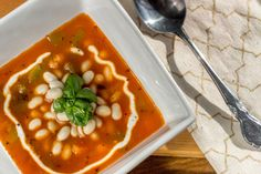 At the Immigrant's Table: Pasulj Serbian white bean soup With a blend of tomatoes, paprika and creamy white beans, this peppery and tangy soup is filling but light, exactly what you want on a lonely winter's day.