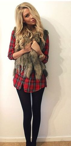plaid shirt and fur vest over it... paired with leggings.. Yep I love it.