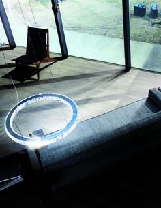 Swarovski's minimalist Circle fixture makes a striking statement with a crystal and stainless steel ring that appears to hover in a room as if by magic. www.architecture.swarovski.com