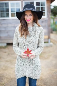 turtleneck tunic sweater and black hat