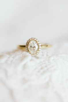 gorgeous yellow gold oval engagement ring | Erin Wilson