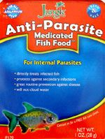 Jungle Anti-Parasite Medicated Fish Food: Metronidazole, Praziquantel, Levamisole. For internal flagellates, trematodes, and cestodes, which includes hexamita (hole-in-the-head), spironucleus, intestinal worms, tapeworms, and nematodes, e.g. camallanus.  Feed exclusively for 3 consecutive days a week for 4 weeks.  Can mix with a little Garlic Guard to make it taste better. Do not offer any other food. Fish will eventually eat it. Can be used with whole tank treatments. Safe for loaches.