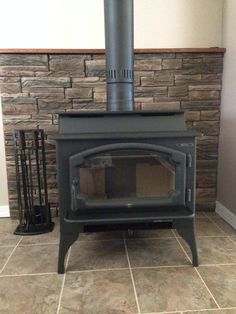 hearth floor ( Lowe's), Lopi Liberty woodstove ( The Fireplace People