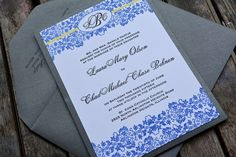 Letterpress wedding invitation with a blue and yellow damask design by Lucky Invitations.