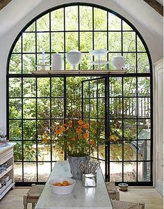 from Absolutely white: doors overlooking patio, shelve above for special pieces #patio #doors