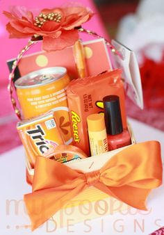 Orange you glad it's your bday - candy, pop, gum, lip salve, nail polish, notepad and pen.