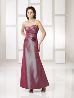 Modified sweetheart neckline with ruched bodice and a flower accent at the natural waistline, in iridescent taffeta.