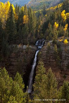 Deep in the Colorado backcountry, off an unnamed dirt road in the San Juan Mountains, lies Mystic Falls.  In autumn, aspens turn bright yellow and contrast sharply with the dark evergreens that surround the falls. #MysticFalls #Colorado #Waterfalls