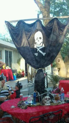 Make a pirate flag on a giant plastic tablecloth from dollar store?
