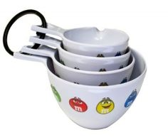 Fun and unique measuring cups for your kitchen decor.  Some of the designs include M & M's, Mickey Mouse, flowers, cupcakes, hearts, butterflies, owls and Snoopy.