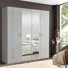 This Anna Four Door Mirrored Wardrobe from Wimex UK offers you plenty of storage with a. Wall Wardrobe Design, Bedroom Built In Wardrobe, Wardrobe Furniture, Bedroom Closet Design, Bedroom Furniture Design, Closet Designs, Home Room Design, Home Decor Bedroom, Armoire Design