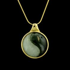 "This pendant is set with nephrite jade and jade symbolizing yin and yang, suspended from a 22"" snake link chain."