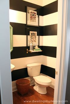 Large black and white stripes add sophistication to the powder room