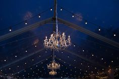 Sweetgrass Social wedding at Magnolia Plantation. Abigael & Oliver. Chandeliers at night in a reception space.