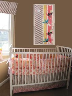 Bright and beautiful bird fabrics and a vintage crib are just a few of the features in this baby's room. http://www.unique-baby-gear-ideas.com/our-baby-girls-colorful-custom-nursery-decor.html