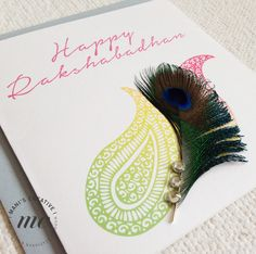 Handmade Rakhi Card Fusing a modern pattern with a traditional peacock feather. A New Rakshabadhan Card collection.