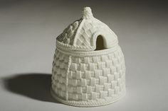 Tiffany Weave Honey Pot A Parian bone china honey pot in the Tiffany Weave design created by Sybil Connolly for Tiffany & Co., New York, USA. This range was manufactured by Celtic Weave China Ireland Ltd., Cloghore, Ballyshannon, Co. Donegal, Ireland.