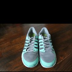 Nike 9.5 Free Run Hard to find Women's Nike Free Run size 9.5 tennis shoes. Tiffany blue with gray mesh tops. Worn but still look great Nike Shoes Athletic Shoes