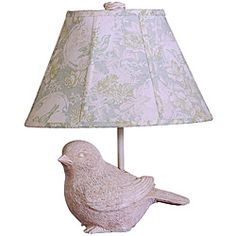 @Overstock - With its whimsical, natural design, this stunning decorative white table lamp makes a charming addition to any room. Crafted with a bird-shaped base, the lamp features a delicate floral linen shade that creates a cool, soothing light.http://www.overstock.com/Home-Garden/Garden-Song-Bird-White-Resin-Table-Lamp/7026383/product.html?CID=214117 $48.49