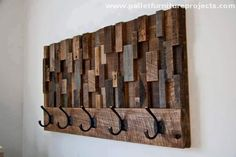 Beginning from this rustic and straight wood pallet shelf. It is a multi purposed shelf, this could also be used as a decoration piece on the wall, while it could also be practically used as an indoor wall shelf. The metallic hooks on it are simply adding much vintage charm.