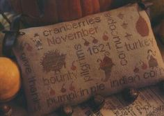 With Thy Needle and Thread November Word Play - November's Door Bells - Cross Stitch. The model was stitched on 35 Ct. Abecedarian linen with Weeks Dye Works an