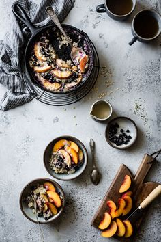 Super Seedy Baked Oatmeal with Peaches and Huckleberries. Also with a maple cashew cream and in a cast iron. Win.