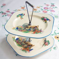 Vintage Cottage Cake Stand with English cottage scene.