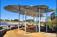 Shade structure with plasma-cut cor-ten steel