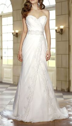 beaded encrusted lace bodice and an A line skirt