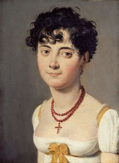She's adorable. Red choker and short messy hair typical of the post-revolutionary French style.