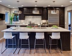 Contemporary Kitchen with Pendant Light, Mont Blanc Marble Countertop, High ceiling, Hardwood floors, One-wall, Breakfast bar