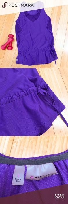 ATHLETA purple tank top, S. Nice purple workout tank top by Athleta, size small. Optional cinching at waist, no internal bra. Excellent condition other than they care tag is faded. Length of top is 26.5 inches. A deep rich royal purple. Athleta Tops Tank Tops