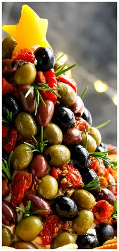 Antipasto Cheese Ball Christmas Tree ~ A showstopper.... Not only is this cheeseball full of sun dried tomatoes, red bell peppers, chives and seasonings on the inside, the OUTSIDE is where it gets antipasto serious!
