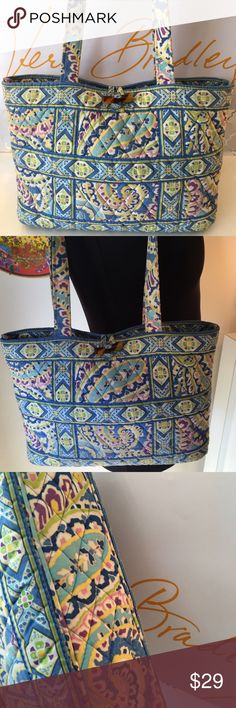 VERA BRADLEY SHOULDER TOTE  AUTHENTIC VERA BRADLEY SHOULDER TOTE 100% AUTHENTIC. STUNNING AND STYLISH.  PERFECT FOR ANY OCCASION AND ALWAYS ON TREND. TWO INTERIOR POCKETS. THE BAG MEASURES 13 INCHES WIDE BY 8.5 INCHES TALL. THE SHOULDER STRAPS HAVE A 11 INCH DROP. Vera Bradley Bags Totes