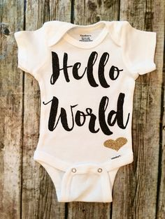 A personal favorite from my Etsy shop https://www.etsy.com/listing/238176418/baby-girl-onesie-hello-world-onesie-for