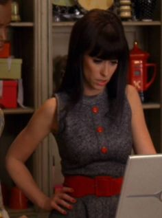 Ghost Whisperer- Season 1, Episode 19- Sleeveless grey, wool dress with red buttons and red belt.