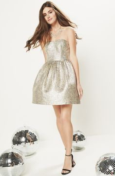 Such a pretty metallic gold strapless skater dress.