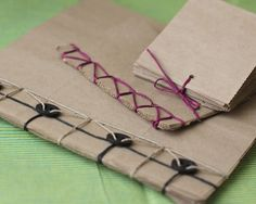 Looking for a way to upcycle paper grocery bags? Make these fantastic little books for notes, journaling, or sketching. Designer Smitha Katti shares this earth-friendly project that could be a great project to do with kids. (I'm thinking Earth Day) Paper Bag Books, Paper Bag Crafts, Paper Bag Album, Diy Paper, Recycle Paper, Paper Craft, Book Bags, Envelopes Decorados, Paper Grocery Bags